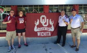 OU Club of Wichita board members flying the colors.