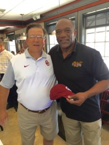 Club scholarship chair Bryce Matteson poses with Billy Sims